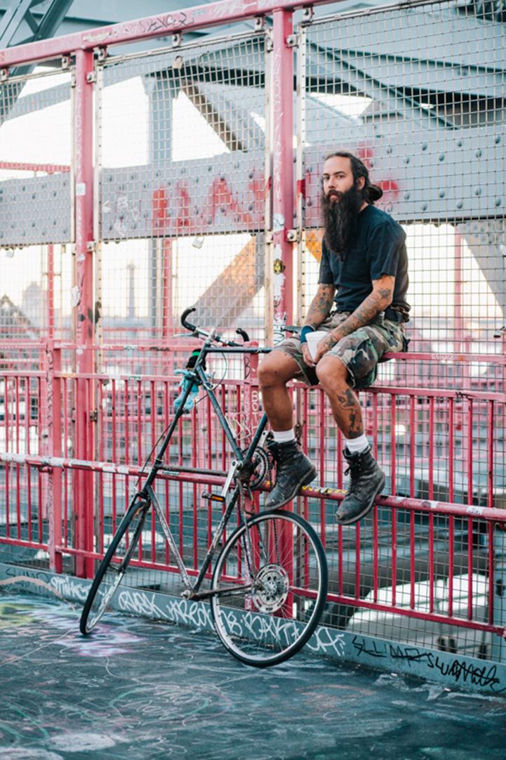 Ian iwah2000@yahoo.com rides a custom tall bike photographed on teh Williamburg Bridge going home from work